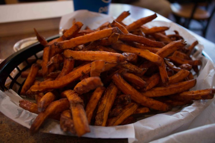 Chowing down on sweet potato fries at my favorite Chapel Hill burger joint: Buns!