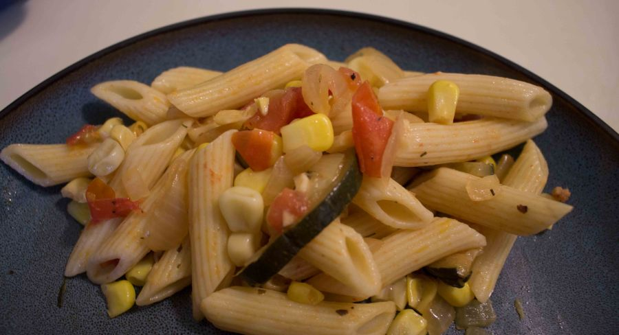 Penne with summer veggies is perfect for a summertime side: it can be served hot or cold, it's light enough to go with a burger but has enough veggies to be a meal on its own!