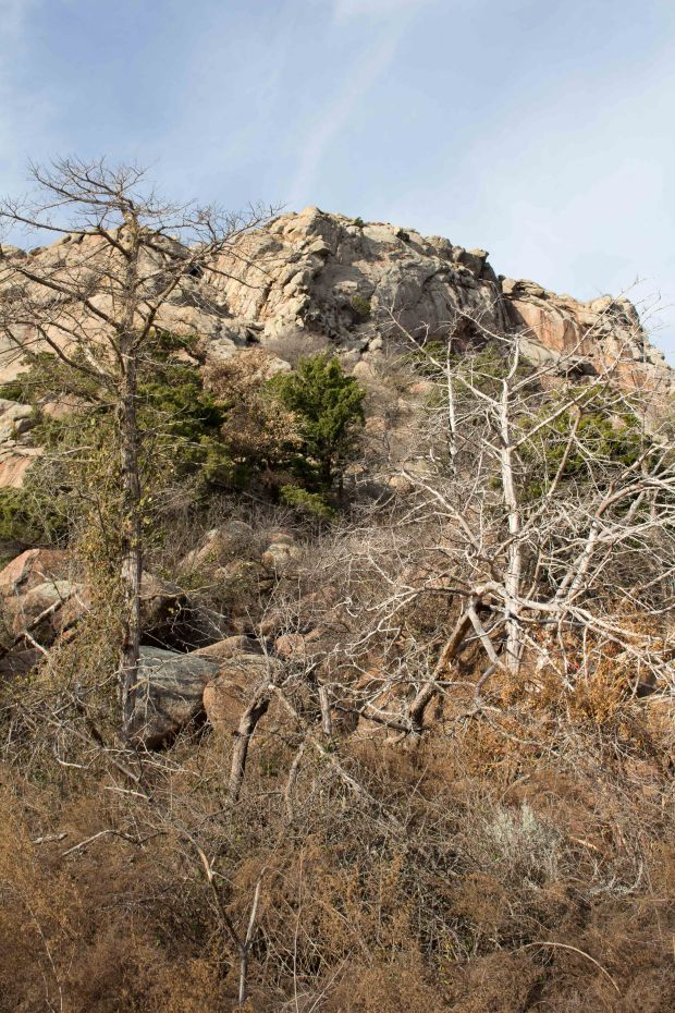 Quartz Mountain's rocky beauty stands out against the Oklahoma sky.